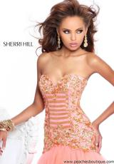 Sherri Hill 2983.  Available in Aqua/Gold, Black/Gold, Coral/Gold, Ivory/Gold